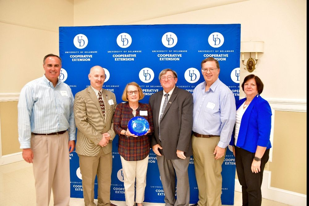 Ernie Lopez (far left), Doug Crouse (second from right) and Michelle Rodgers (far right) present a Friends of Extension award to Joseph Poppiti, Laura Hill and Richard Wilkins of Delaware Farm Bureau.