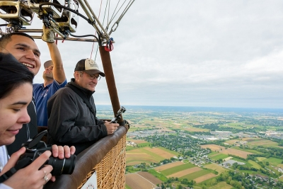 Students with professor Jeff Buler looking at the landscape from a hot air balloon