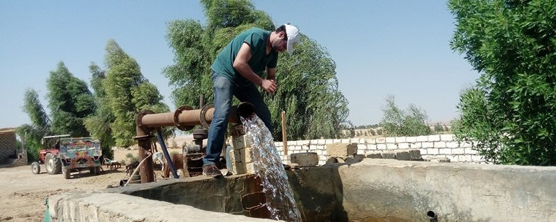 A graduate student operates a groundwater pump in Egypt