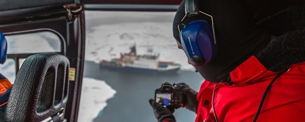 Grad student on a research mission in a helicopter over the Arctic Ocean