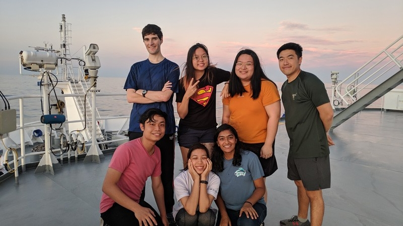 Students, including two from the College of Earth, Ocean and Environment, pose for a photo on the deck of the R/ V Tan Kah Kee, Xiamen University's research vessel.