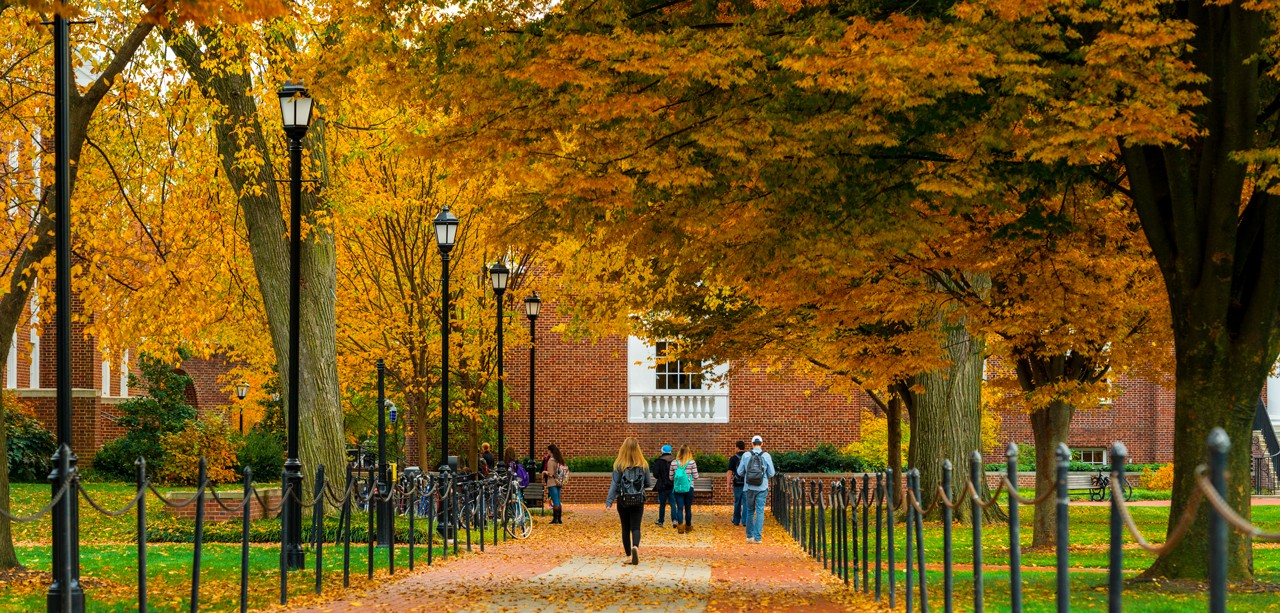 Scene of students walking on the UD main campus during fall.