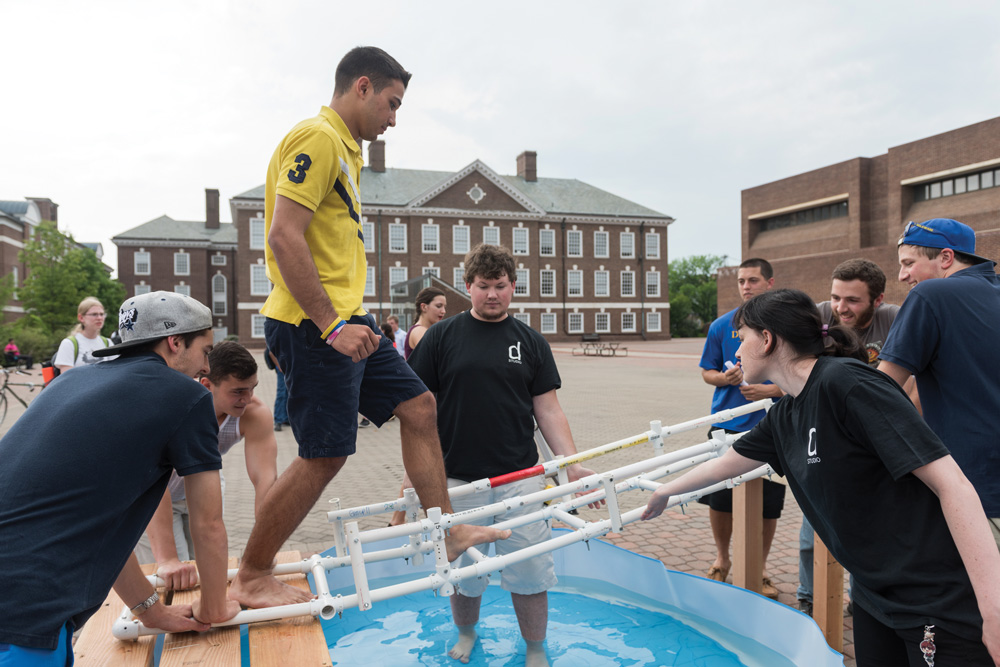 Mechanical engineering students build a makeshift PVC pipe bridge on the UD campus