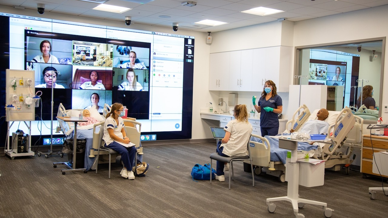 university of delaware health science students in a lab classroom