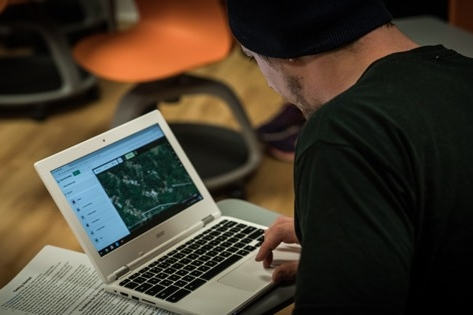 Student using mapping software on laptop