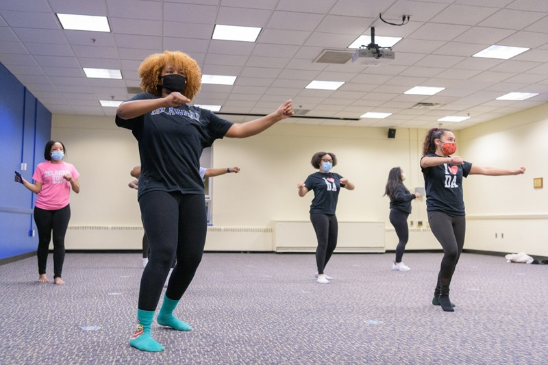 The Dark Arts Dance Company is among hundreds of student organizations at UD that have continued safe engagement — and, in this case, performance — during the pandemic. Here, pictured left to right, Deanna Desgouttes, Stefanie Severin, Jasmyn Allen and Adamari Rodriguez prepare for a spring showcase that will stream virtually.