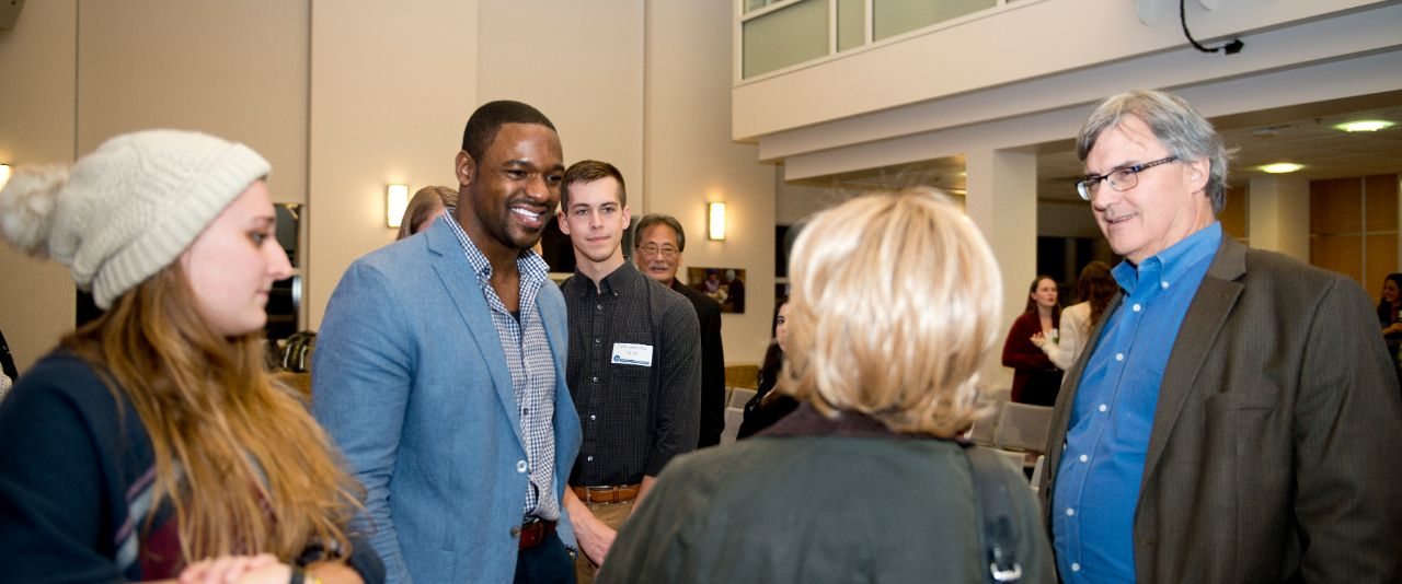 Courtney Campbell chats with students and fellow alumni at the University of Delaware.