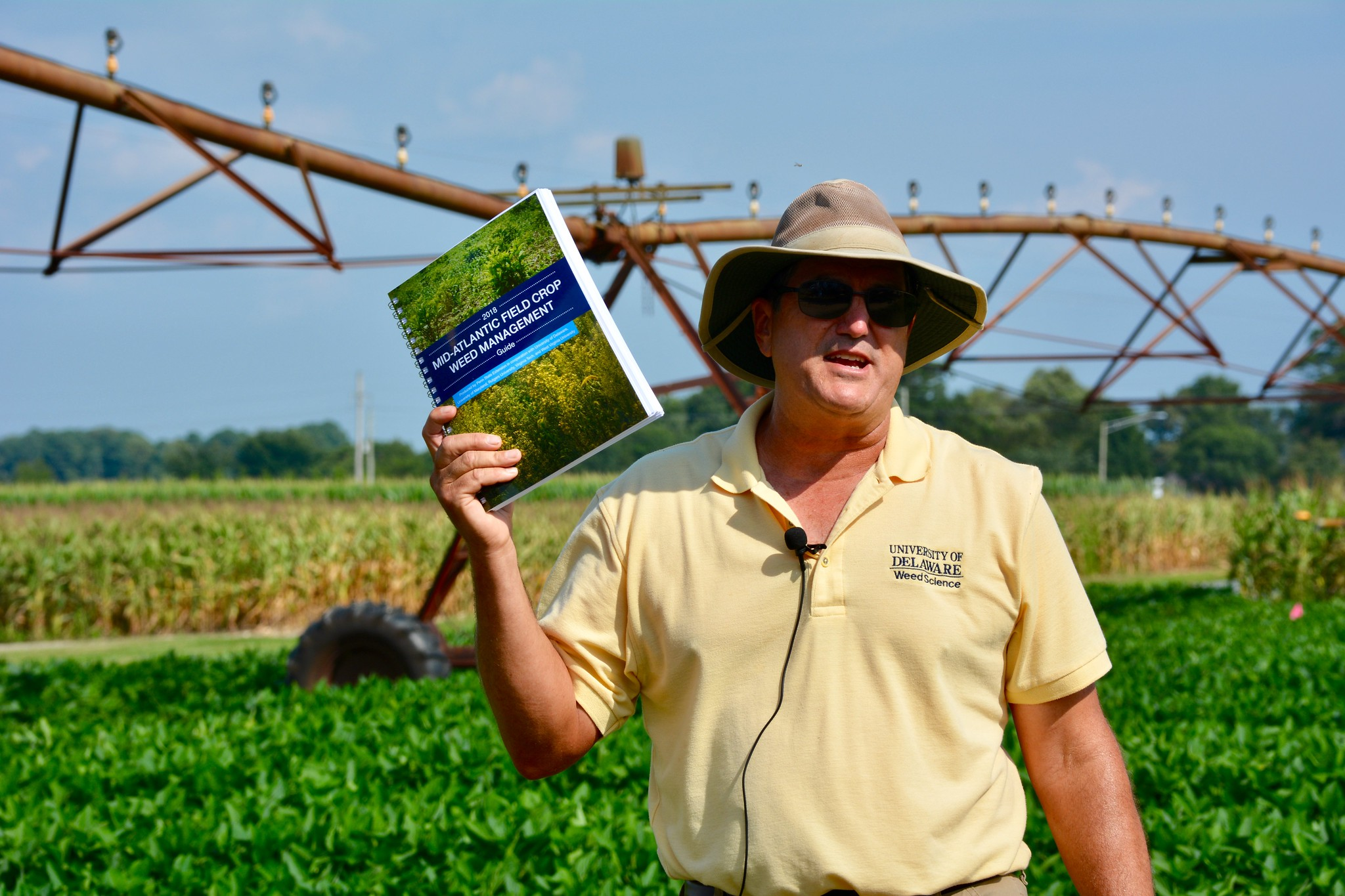 Msrk VsnGessel holding up weed guide at recent weed day tour