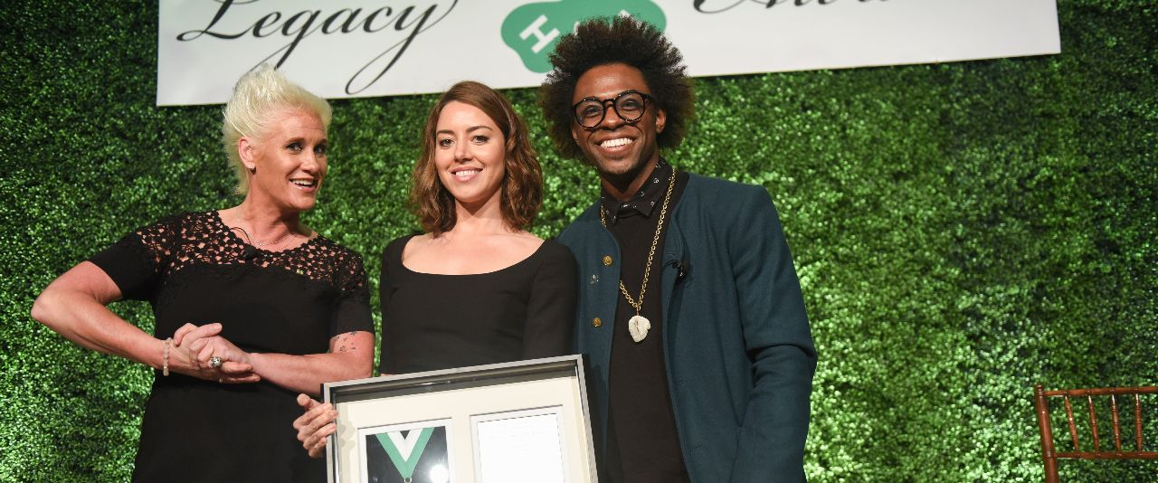 Chef Anne Burrell, left, and chef Lazarus Lynch, right, present the Distinguished Alumni Medallion to actress Aubrey Plaza during the National 4-H Council Legacy Awards on Tuesday in Washington. (Kevin Wolf/AP Images for National 4-H Council)