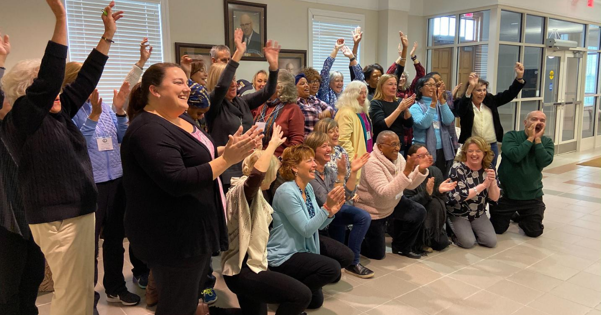 The 2019 Master Gardener class cheers for their class photo.