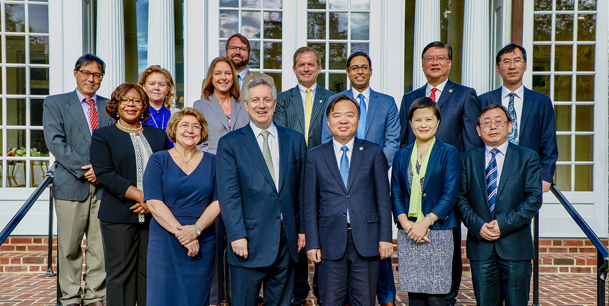 UD's President Dennis Assanis stands with a delegation of faculty, staff and representatives from Xiamen University.