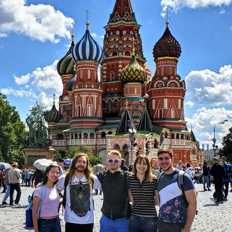 A group of students stand in front of St. Basil's in Moscow, Russia.