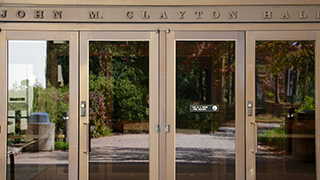 A photo of the doors of Clayton Hall.