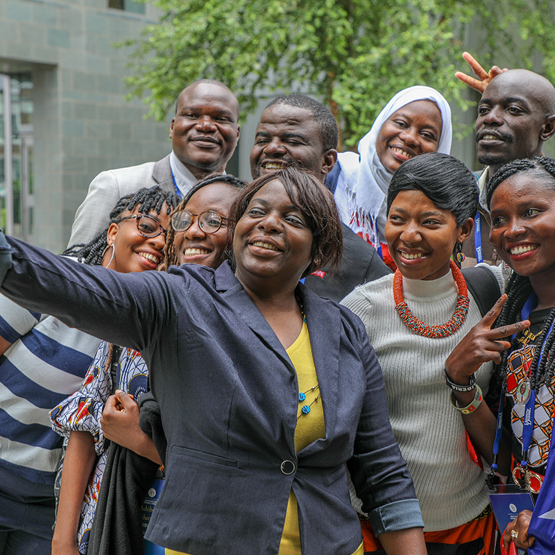 Fellows take a selfie with the program's Academic Director Nike Olabisi.