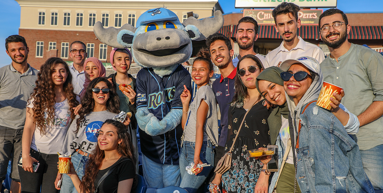 UD MEPI Student Leaders pose for a photo with the Blue Rocks Mascot, Rocky.
