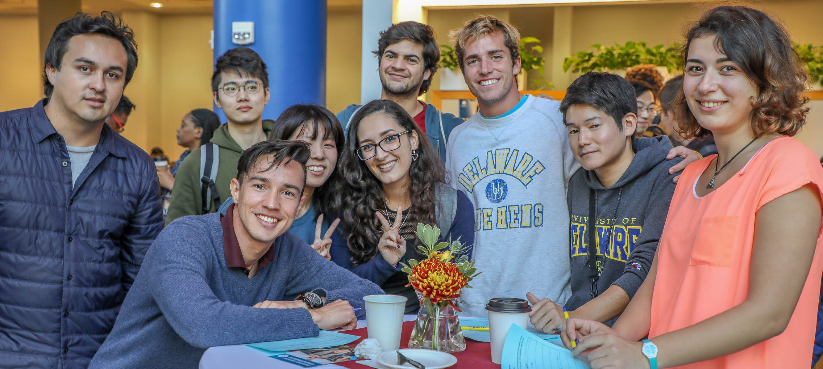 Students pose for a photo at International Coffee Hour