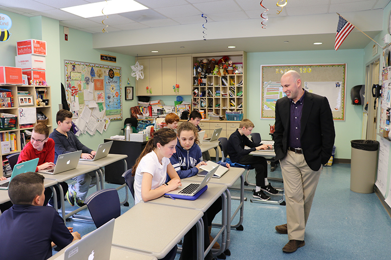 Joshua Wilson works with students at The College School.