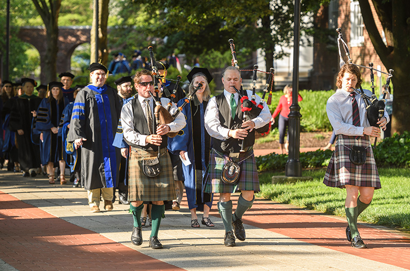 The UD Doctoral Hooding Ceremony procession begins when the bagpipers do. This year students, faculty mentors and University officials were led by pipers (left to right) Mark Hurm, David Bailiff and Joe Hurm.