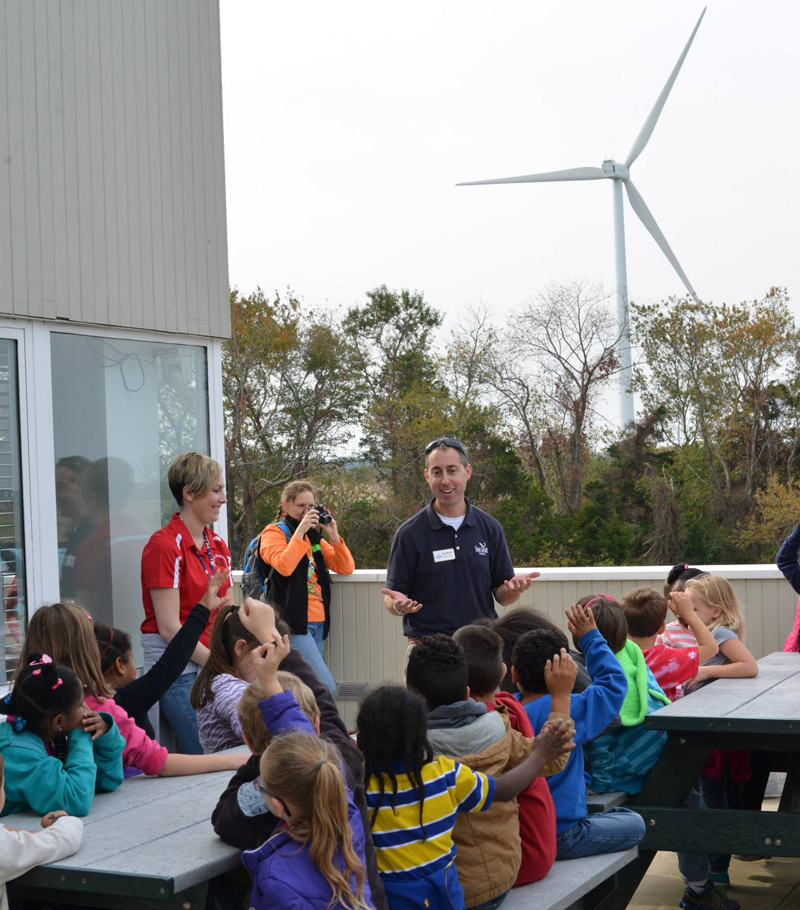 First graders from Smyrna Elementary school learn about wind energy from Delaware Sea Grant marine education specialist Chris Petrone.