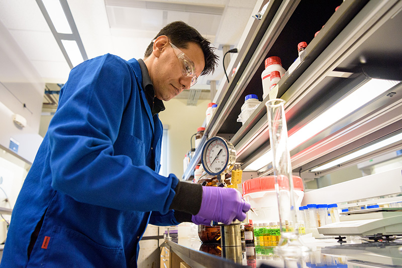 "Saikat Dutta, postdoctoral researcher at UD's Catalysis Center for Energy Innovation, conducts experiments with catalysts, the chemical ""goats"" that kickstart chemical reactions. His work was critical to the development of two catalytic processes important to the production of renewable jet fuel, reported recently in ACS Catalysis, a journal of the American Chemical Society."