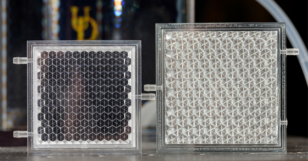 Keith Goossen, a UD associate professor, is designing new prototypes of smart glass panels, like the two shown here.