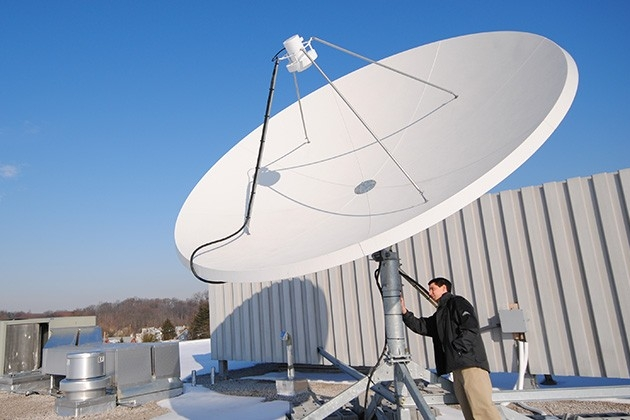Satellite receiving station equipment installation on the roof of Willard Hall