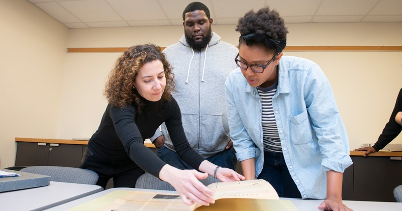 Students examine historical documents related to Wilmington