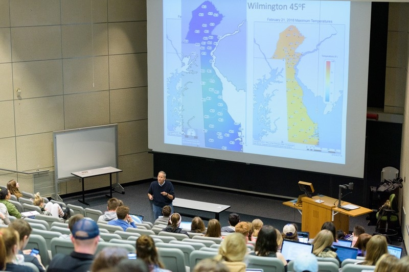 Environmental conditions lecture with Delaware temperature maps on display