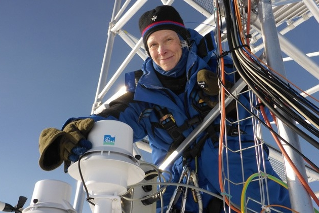 Professor Dana Veron on meteorological equipment tower in Antarctica