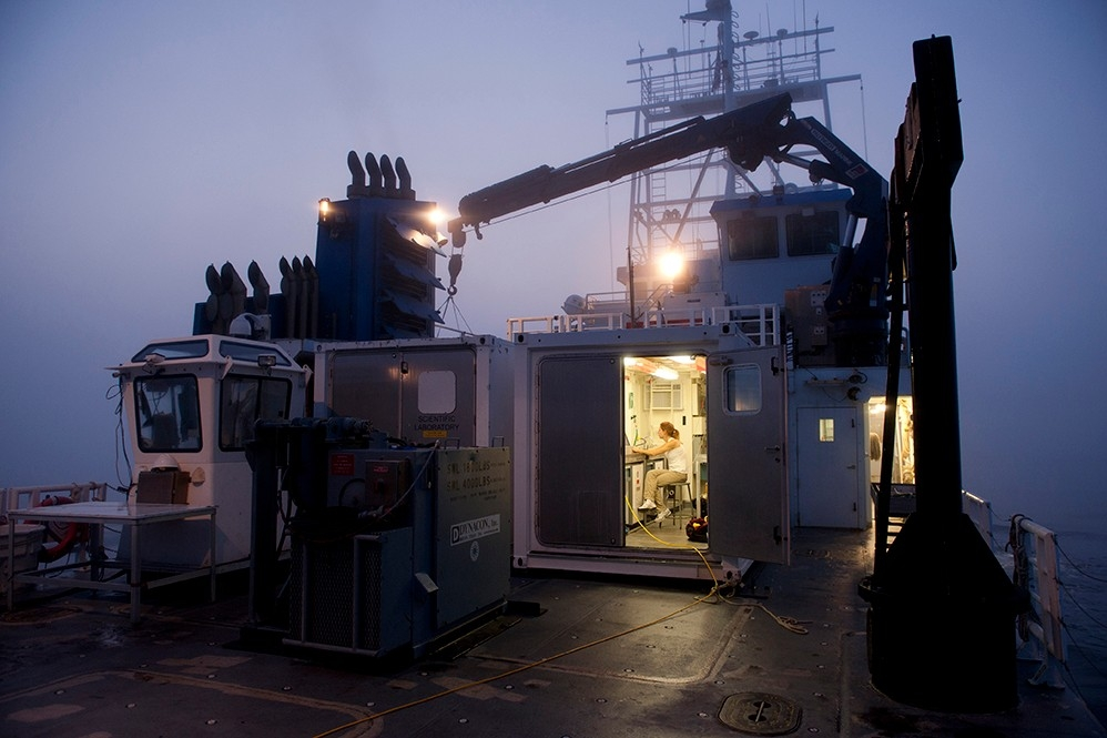 Researcher at work in UNOLS Van lab onboard the R/V Sharp