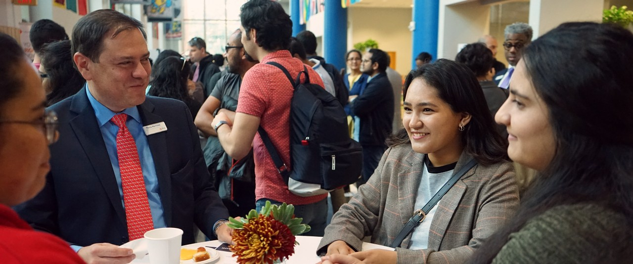 Staff meet with international students and scholars at international coffee hour