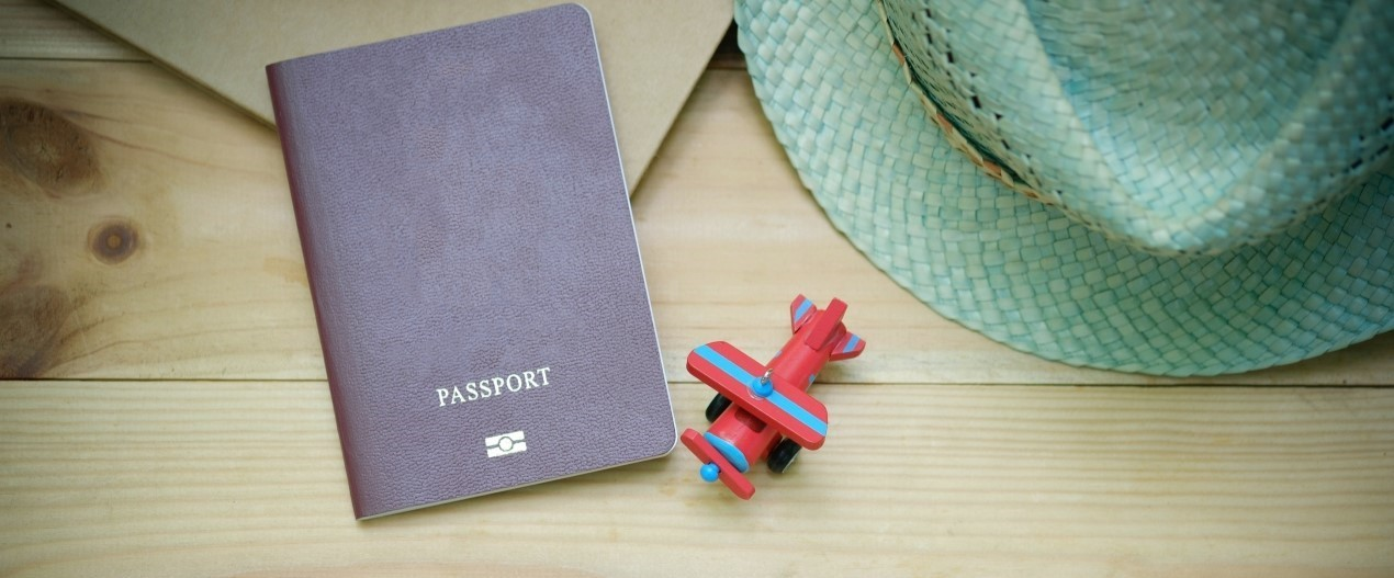 Passport with small toy airplane