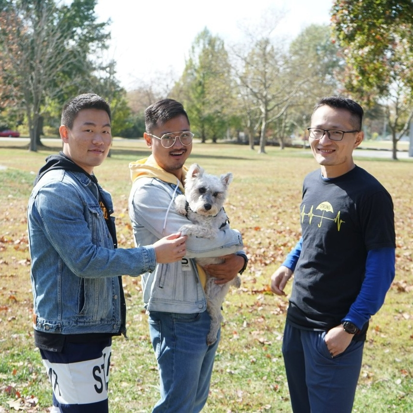 A photo of students and a dog