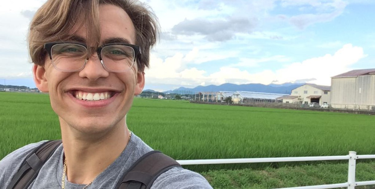 Rickey Egan smiles for a selfie during his CLS program in Japan.