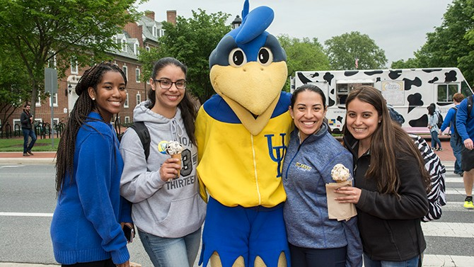 Student pose with YouDee and their UDairy ice cream.