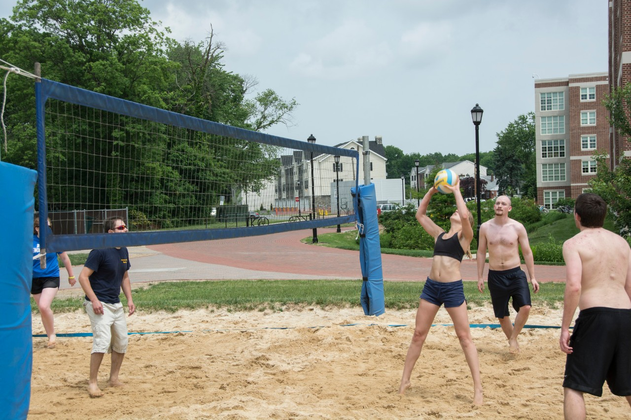 Students play volleyball on the Beach.