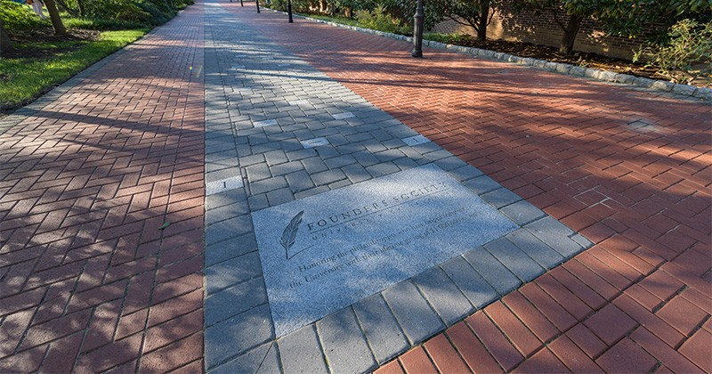 Close up photograph of the Founder's Walkway near the Amy DuPont Hall.