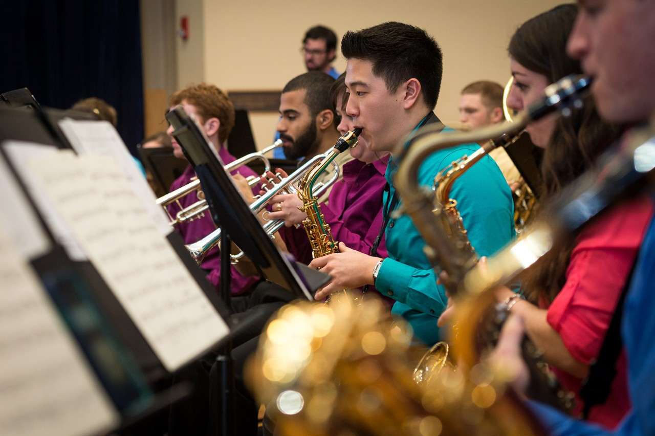 Members of the UD band play brass instruments.