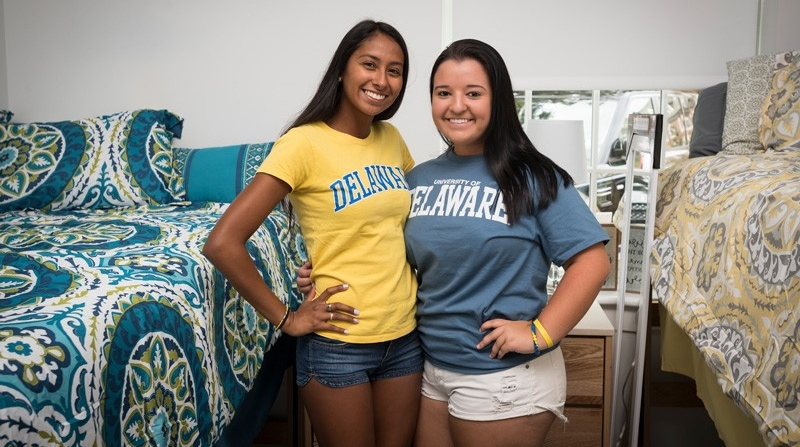 two female roommates standing in their residence hall room
