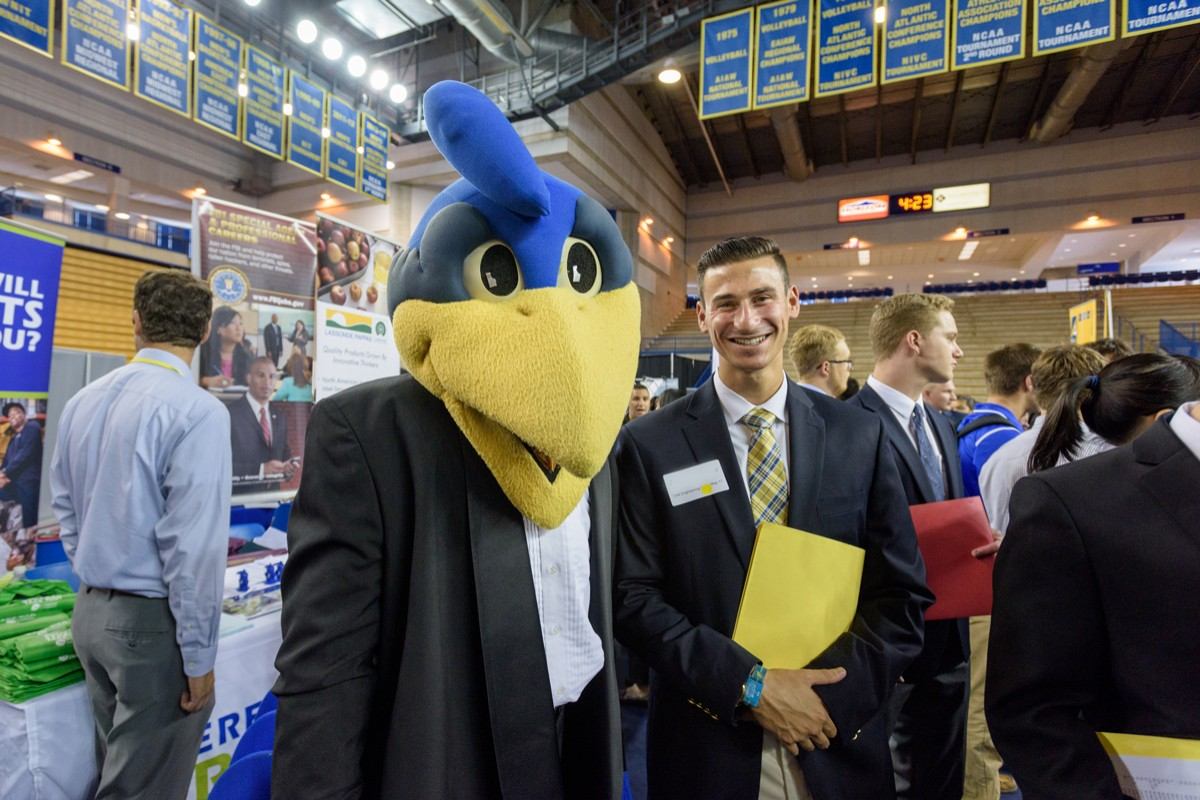 YouDee mascot and student at a Career Fair.