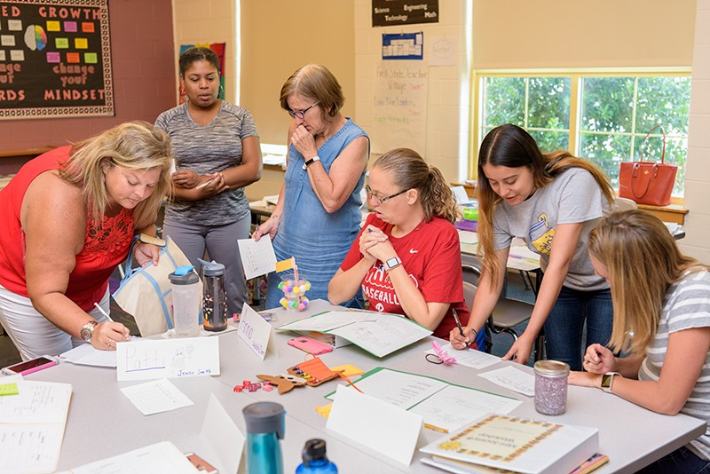 Teachers learn how to use the Mini-Society curriculum in their own classroom.