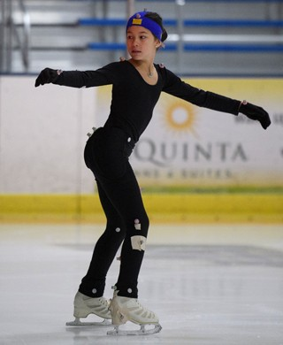Competitive skater Alysa Lin prepares for a jump