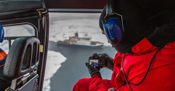 Scott Sorenson in helicopter over the Arctic Ocean