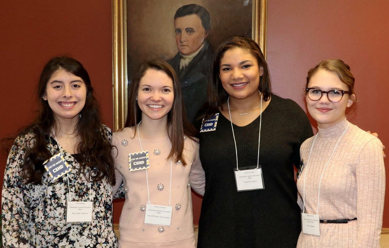Hearst Scholarship recipients Nicole Mejia (left) and Ayanna Bundy (third from left) are pictured with CEHD classmates Natalie Ventura and Kerry Ann Pini.
