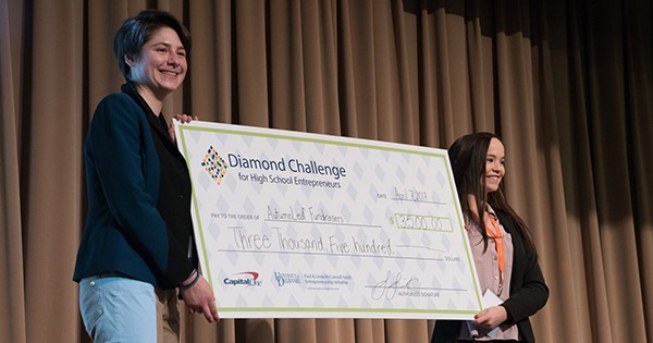 Diamond Challenge third place winners for the social innovation track, AutumnLeaf Fundraisers, pose with their prize.