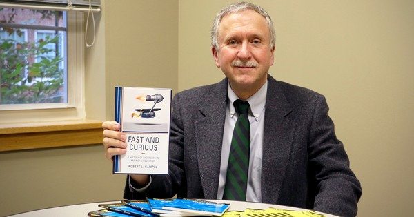 Robert Hampel displays his latest book Fast and Curious: A History of Shortcuts in American Education.