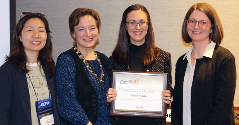 As faculty members on Alison Hooper's dissertation committee, HDFS professors Myae Han (left) and Martha Buell (second to left) joined Hooper and AERA award presenter Katherine Delaney (far right).