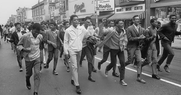 High school students march along Market Street in Wilmington to attend a memorial service for Martin Luther King Jr. in April 1968