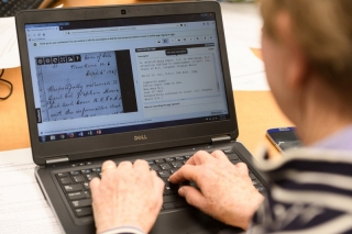 A University of Delaware volunteer transcribes minutes from a Colored Convention into the digital record.