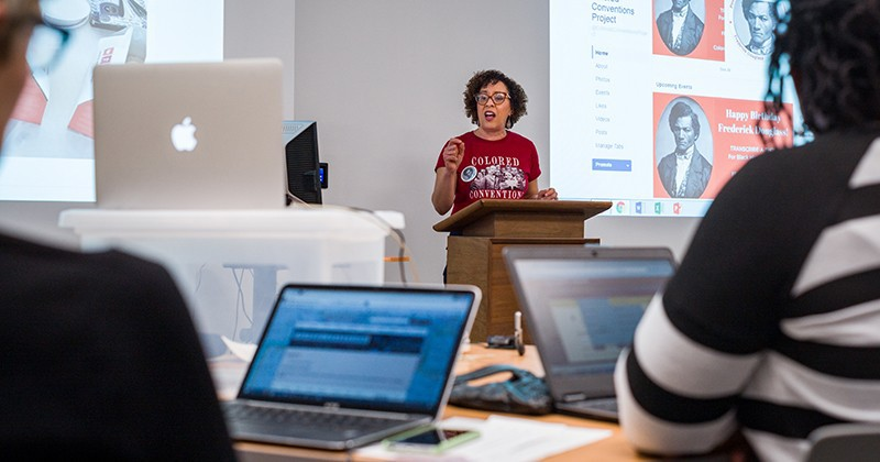 "P. Gabrielle Foreman, founding faculty director of the Colored Conventions Project, leads volunteers in a ""transcribe-a-thon"" at UD's Morris Library on Frederick Douglass Day 2017."